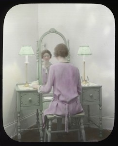 Woman at mirror, circa 1930s: Seattle Municipal Archives
